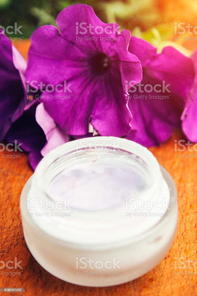 Composition of face cream and flowers stock photo