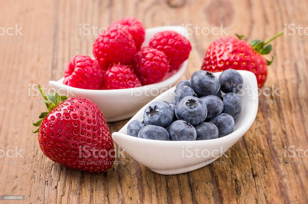 Composition of fresh blueberries, raspberries and strawberries stock photo