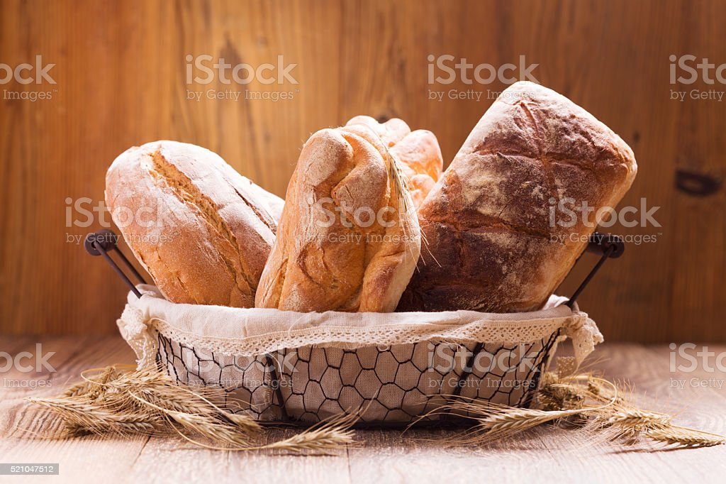 Composition of fresh bread, cereals and grains. stock photo