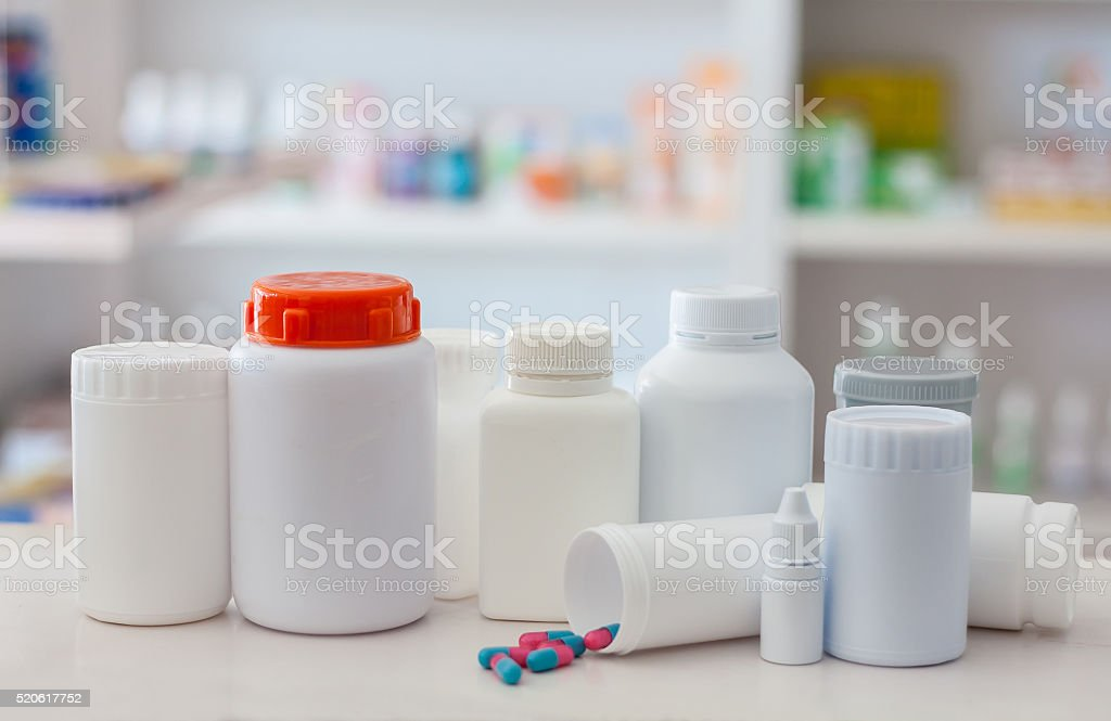 Composition of medicine bottles and pills stock photo