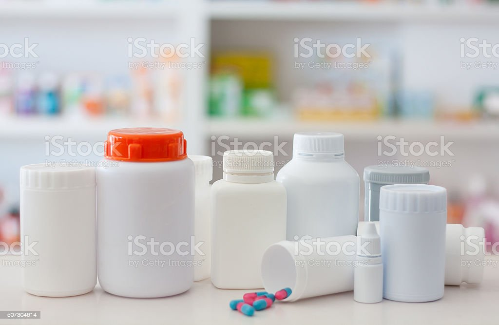 Composition of medicine bottles and pills with pharmacy store stock photo
