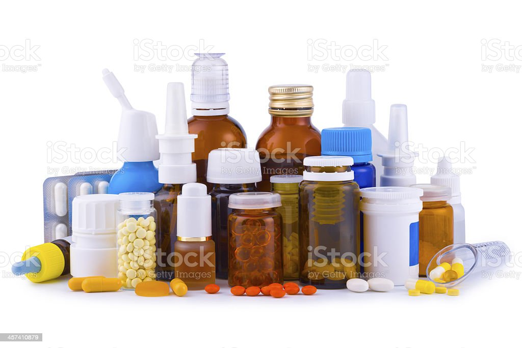 Composition of medicine bottles, pills and capsules isolated on white stock photo