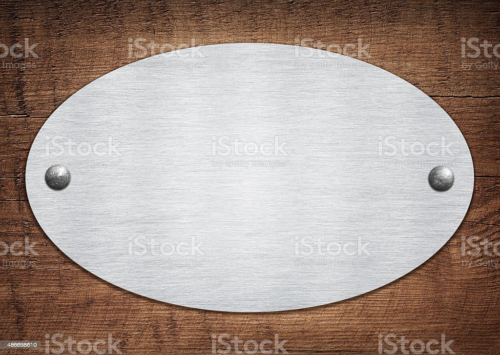 Composition of metal aluminum plaque, name plate on wooden plank stock photo