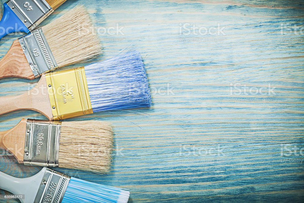 Composition of paint brushes on wood board construction concept stock photo
