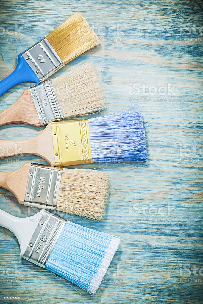 Composition of paintbrushes on wooden board construction concept stock photo