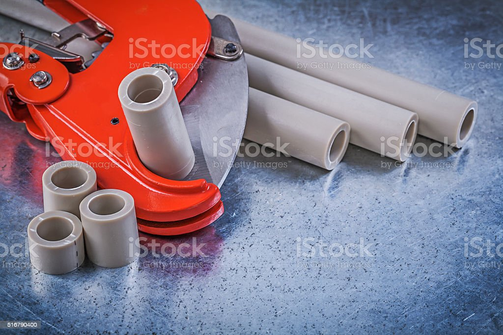 Composition of plumbers tools on metallic background constructio stock photo
