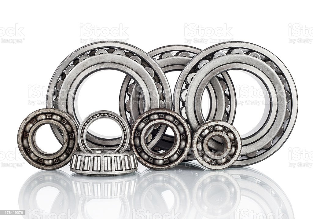 Composition of steel ball roller bearings in closeup isolated stock photo