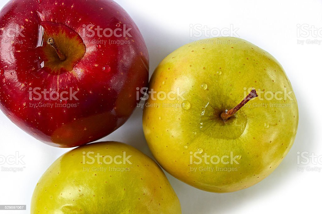 Composition of three fresh, healthy, wet apples stock photo