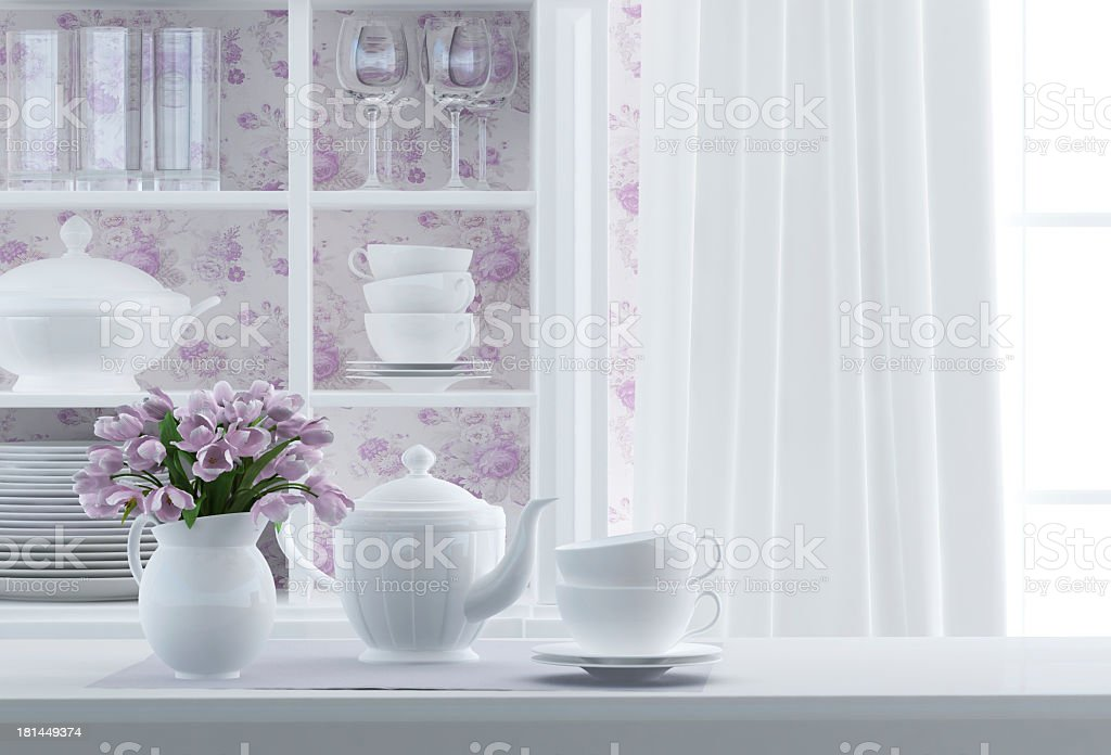 Composition of white kitchenware and vase of purple flowers stock photo