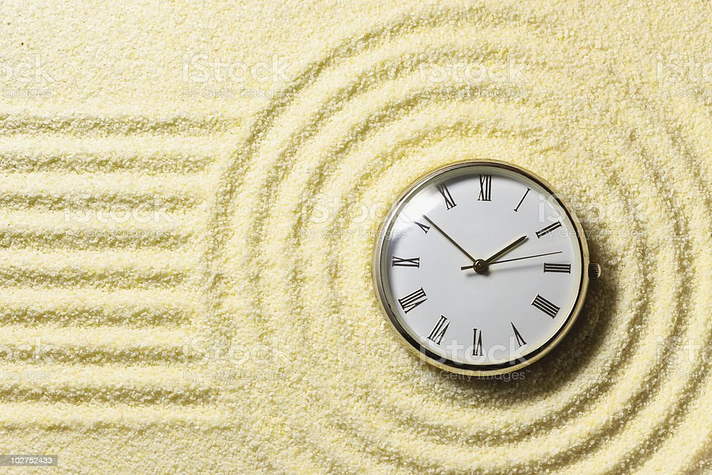 Composition on Zen garden - sand, and watch royalty-free stock photo