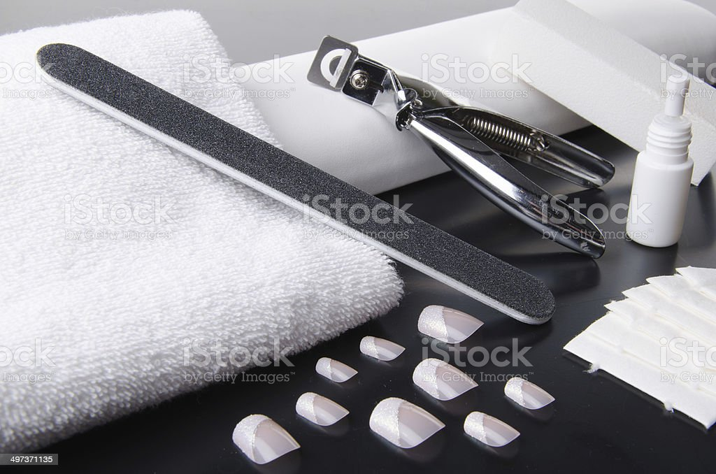 Composition with an equipment of false-nails application stock photo