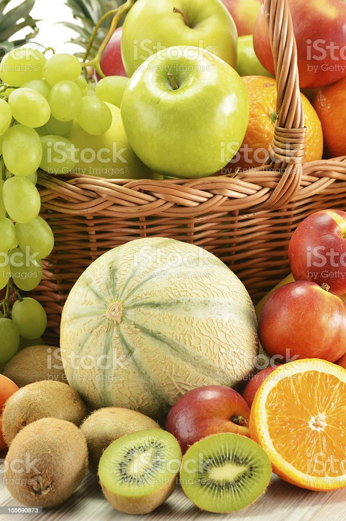 Composition with assorted fruits in wicker basket royalty-free stock photo