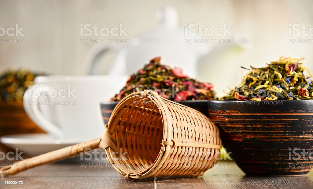 Composition with bowls of tea leaves stock photo
