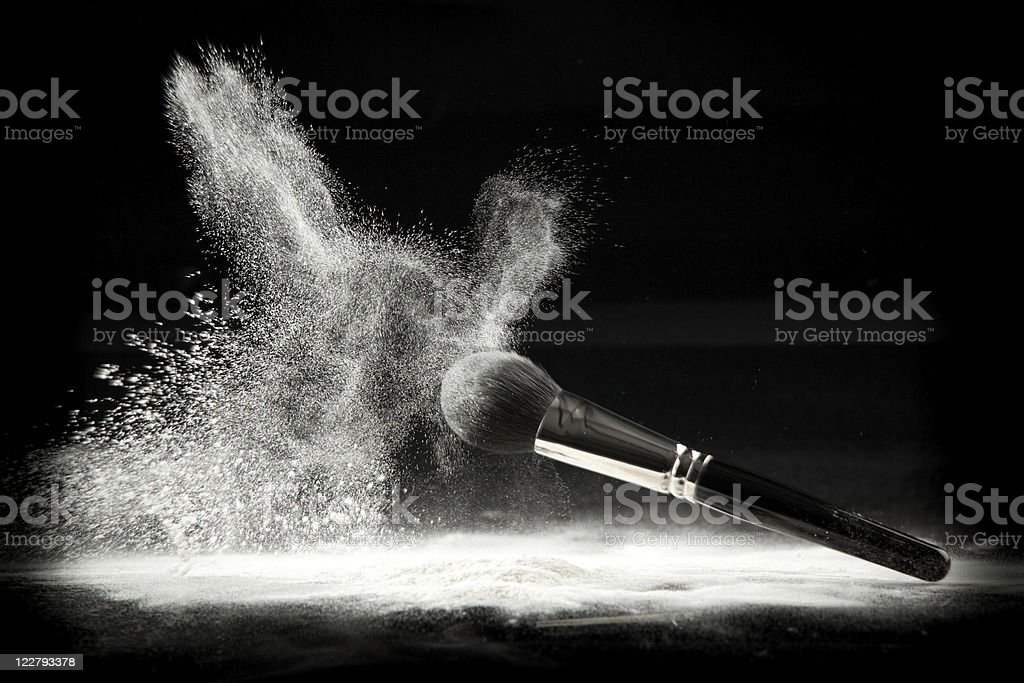 composition with brush and white loose powder stock photo