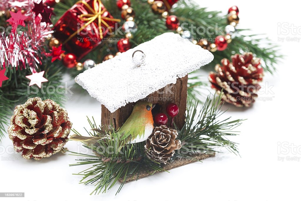 composition with Christmas decorations-birdhouse, spruce branches royalty-free stock photo