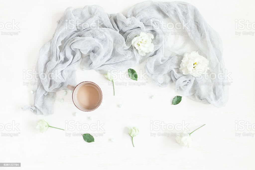 Composition with coffee and white flowers. Flat lay, top view