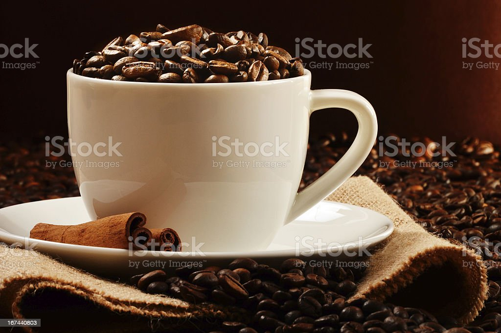 Composition with cup of coffee and beans royalty-free stock photo
