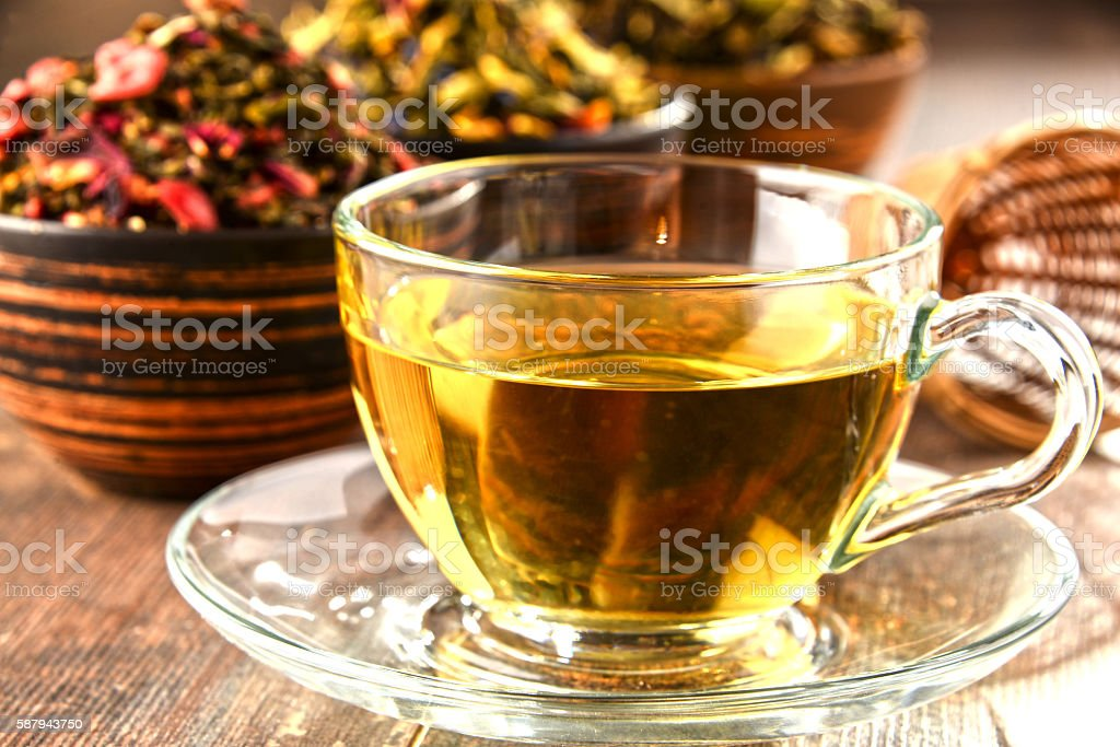 Composition with cup of tea and bowls of tea leaves stock photo
