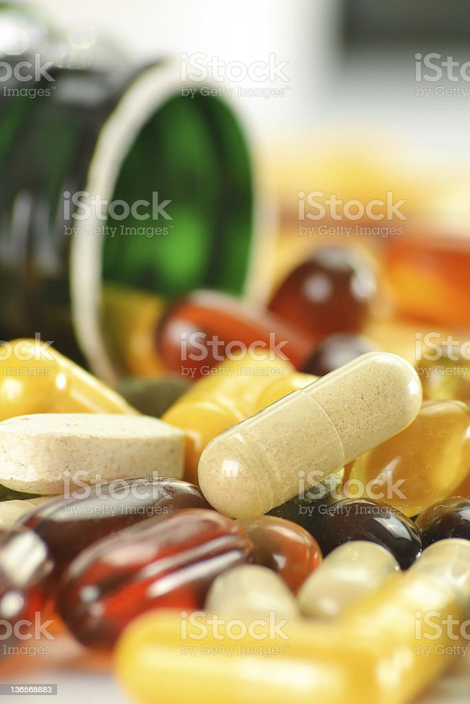 Composition with dietary supplement capsules and containers stock photo