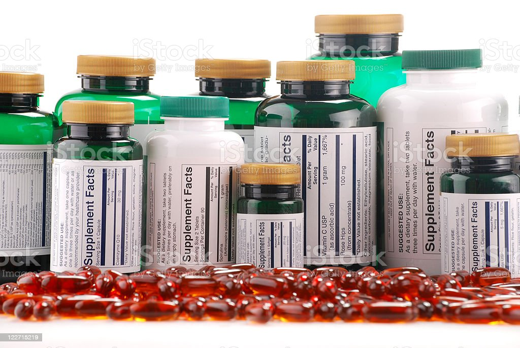 Composition with dietary supplements capsules and containers stock photo