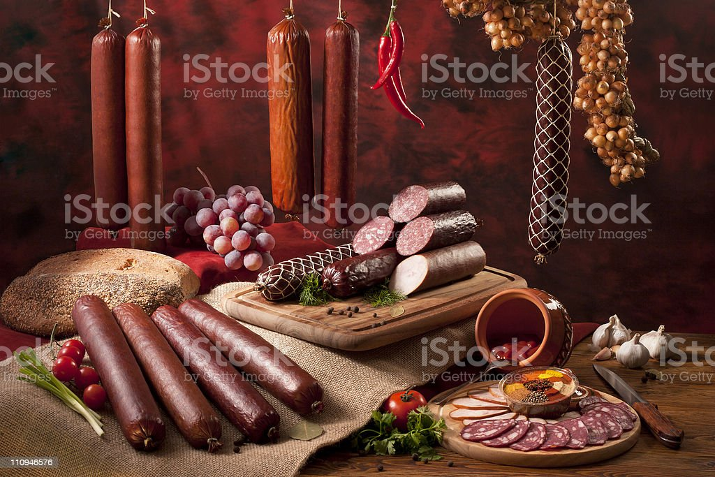Composition with different sorts of sausages stock photo
