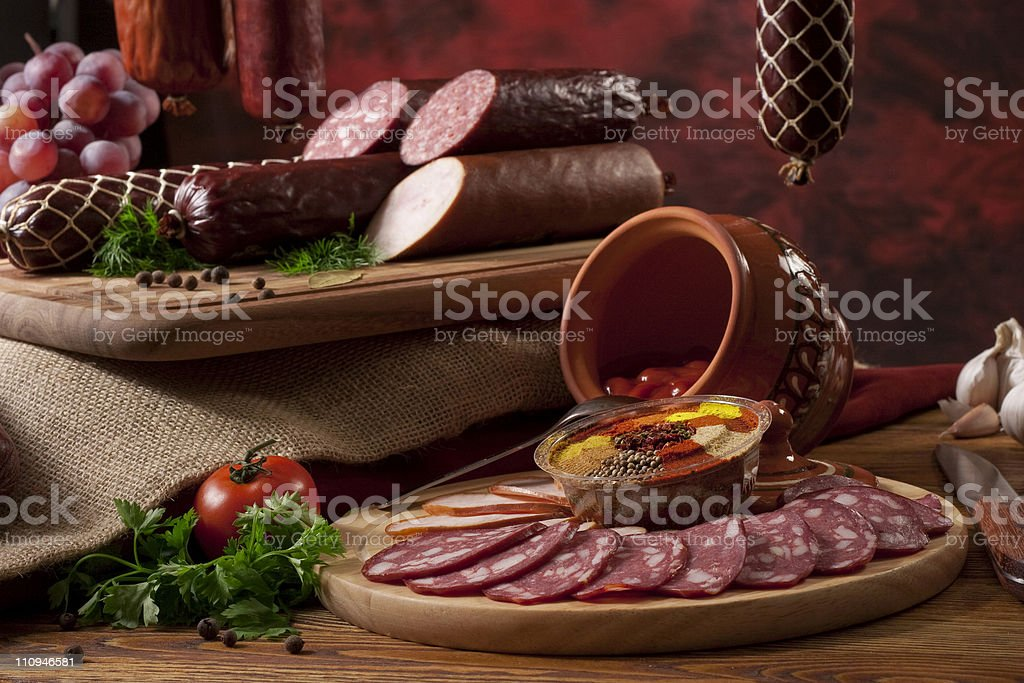 Composition with different sorts of sausages royalty-free stock photo