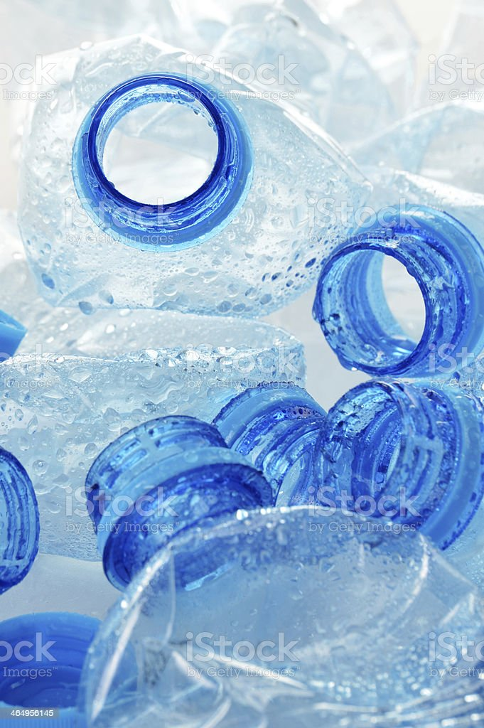 Composition with empty polycarbonate plastic bottles of mineral stock photo