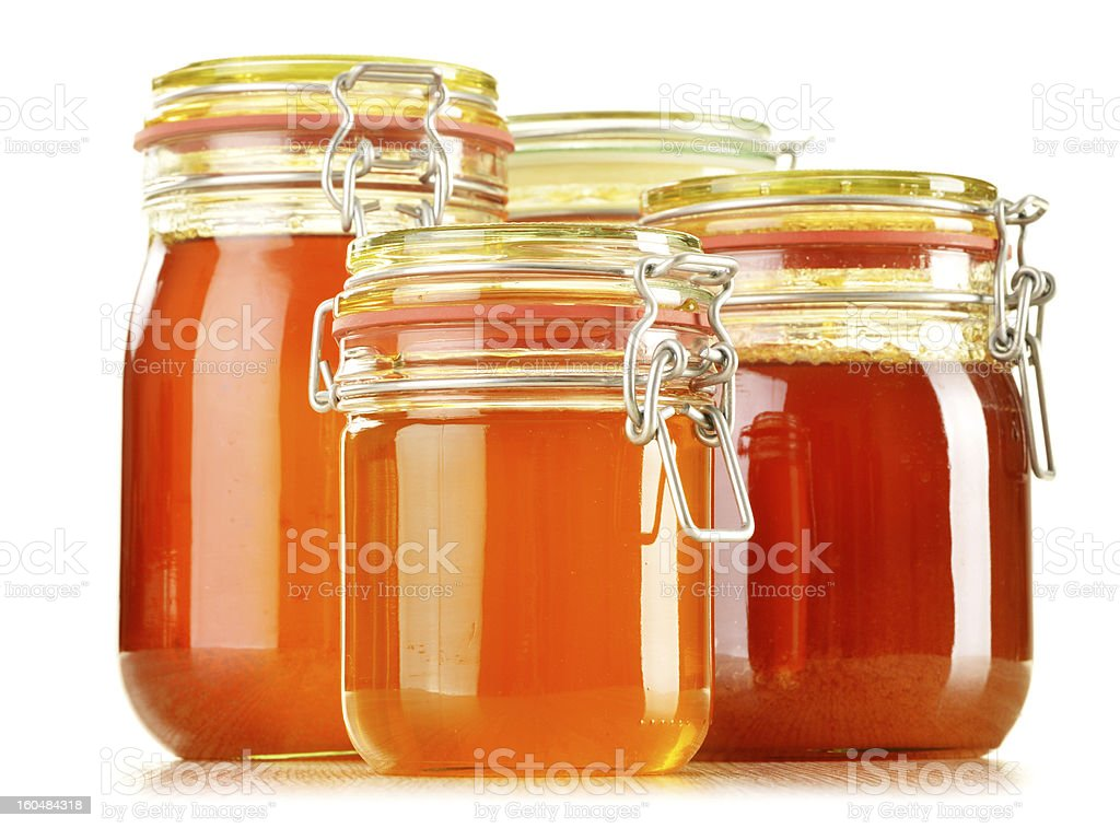Composition with jars of honey isolated on white royalty-free stock photo