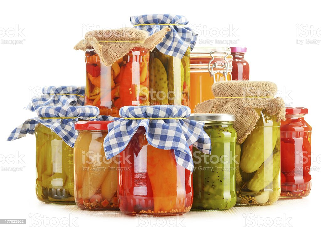 Composition with jars of pickled vegetables isolated on white stock photo