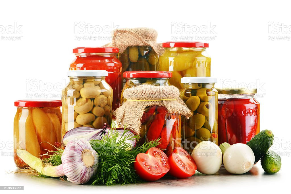Composition with jars of pickled vegetables. Marinated food stock photo