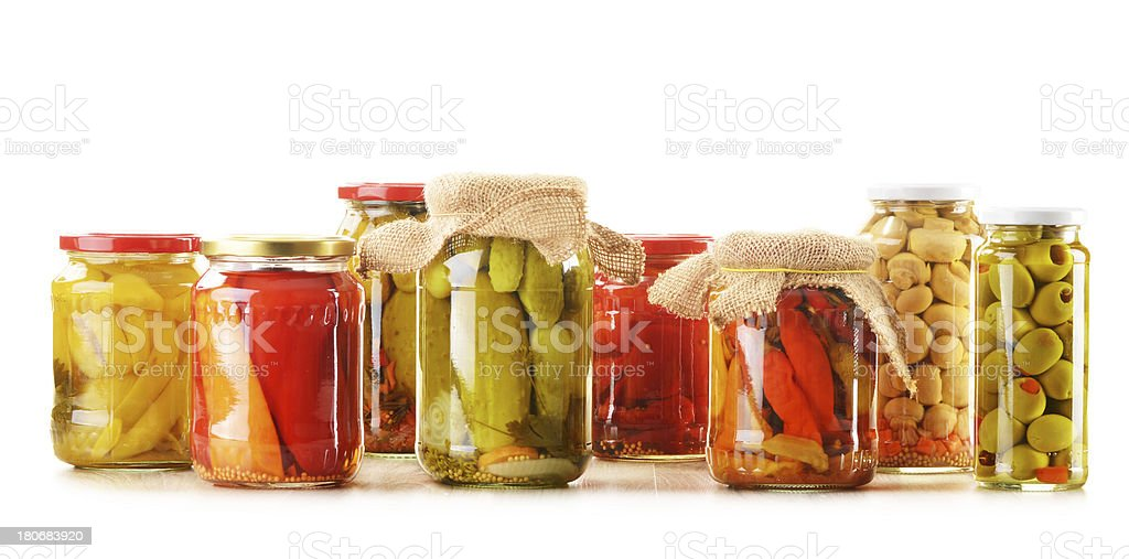 Composition with jars of pickled vegetables stock photo