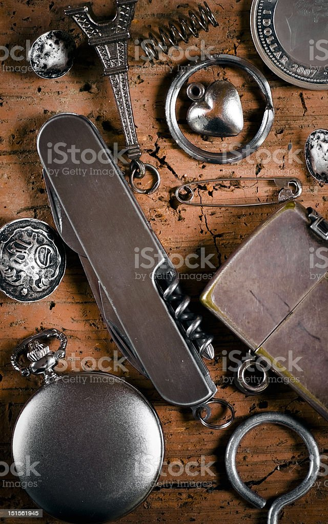 composition with knife, pocket watch and lighter stock photo