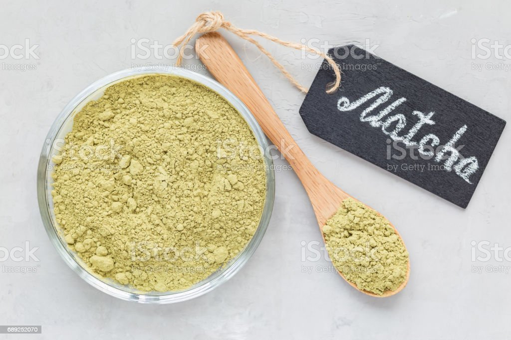 Composition with matcha green tea powder and chalk board, top view, horizontal stock photo