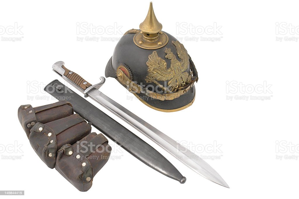 Composition with old German helm, bayonet and cartridge pouch royalty-free stock photo