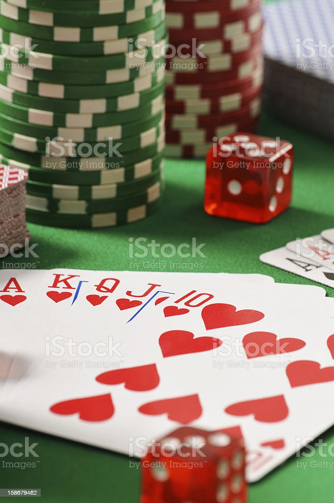 Composition with playing cards on green table royalty-free stock photo