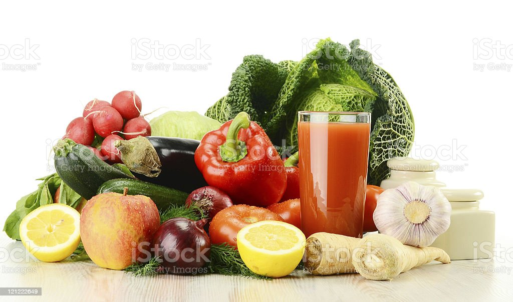 Composition with raw vegetables and glass of juice royalty-free stock photo