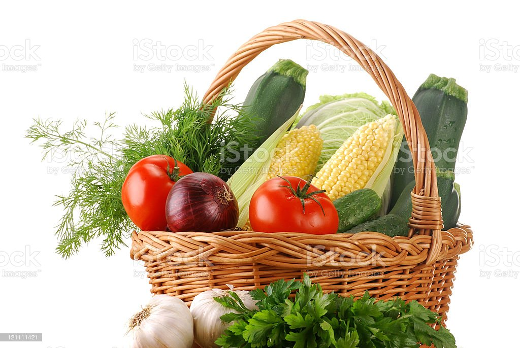 Composition with raw vegetables and wicker basket isolated on white royalty-free stock photo