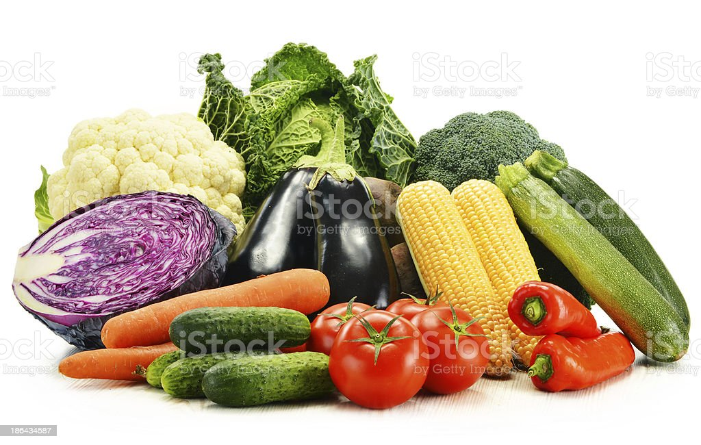 Composition with raw vegetables isolated on white royalty-free stock photo