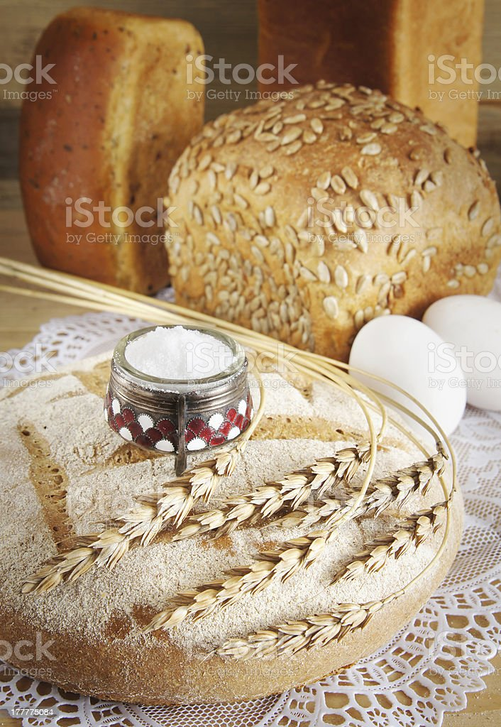 Composition with round rye loaf and salt royalty-free stock photo