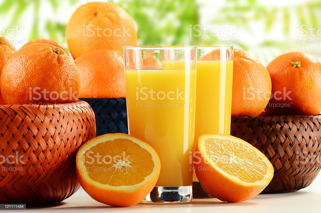 Composition with two glasses of orange juice and fruits royalty-free stock photo