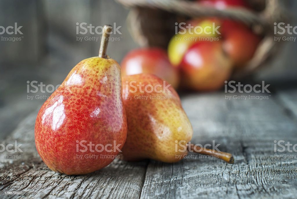 Composition with Two Red Pears on the dark wooden table royalty-free stock photo