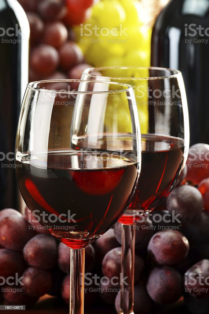 Composition with two wineglasses and bottles of wine royalty-free stock photo