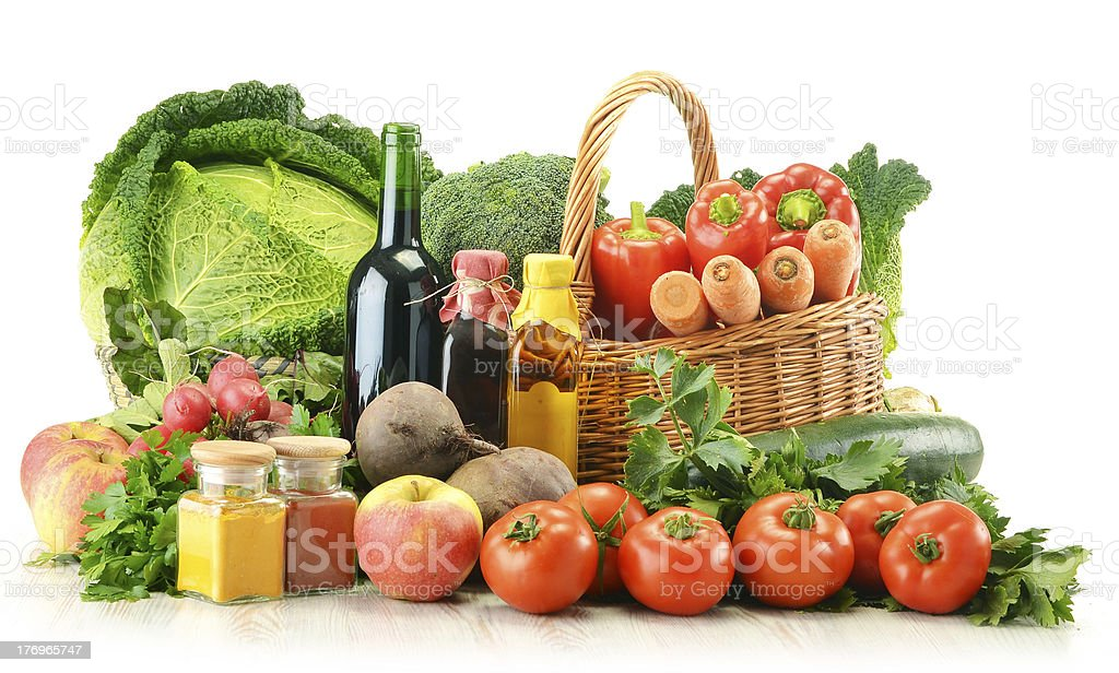 Composition with variety of raw vegetables and wicker basket royalty-free stock photo