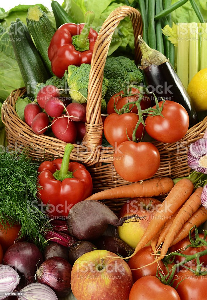 Composition with variety of raw vegetables in wicker basket royalty-free stock photo
