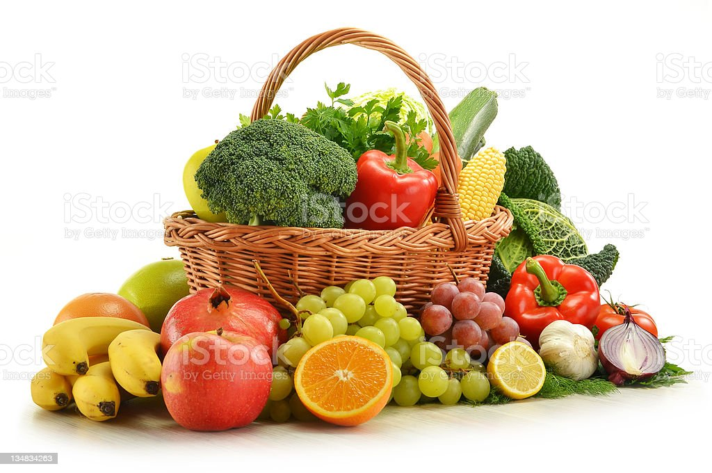 Composition with vegetables and fruits in wicker basket royalty-free stock photo