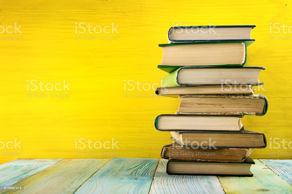 Composition with vintage old hardback books, diary, fanned pages stock photo