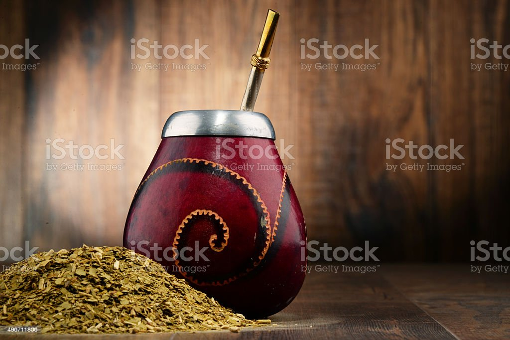 Composition with yerba mate cup and leaves stock photo