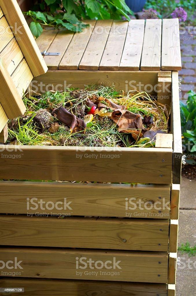 Compost in wooden box on sidewalk stock photo