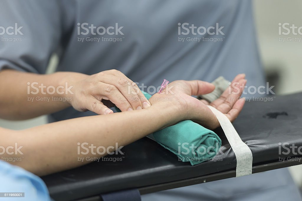 compress arterial cannula before connect monitor stock photo