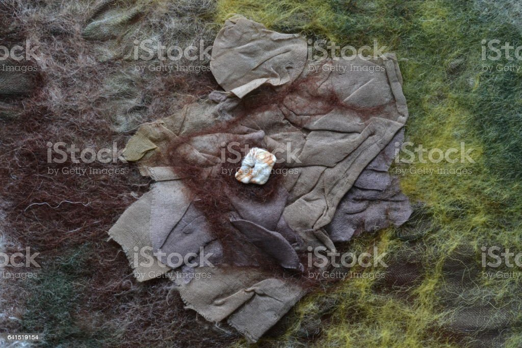 Compressed brown silk with wool matted locks stock photo